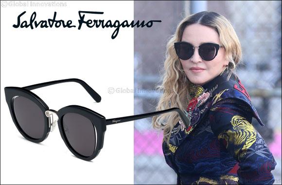 Madonna wears Salvatore Ferragamo eyewear.